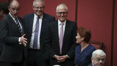 Treasurer Scott Morrison and Prime Minister Malcolm Turnbull in discussion with Pauline Hanson in the Senate in February 2018.