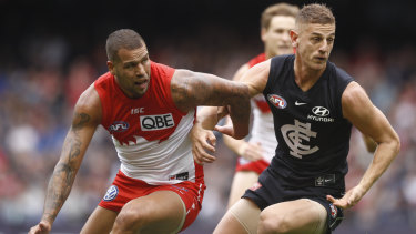 Liam Jones does battle with Sydney's Lance Franklin.