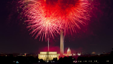 Fourth of July fireworks explode over Lincoln Memorial, Washington Monument and US Capitol, along the National Mall in Washington.