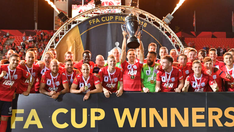 Adelaide United players celebrate after winning the FFA Cup final match against Sydney FC.