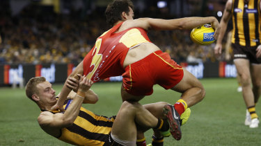 Gritty defence: Hawk James Worpel brings down Gold Coast's Jack Bowes.