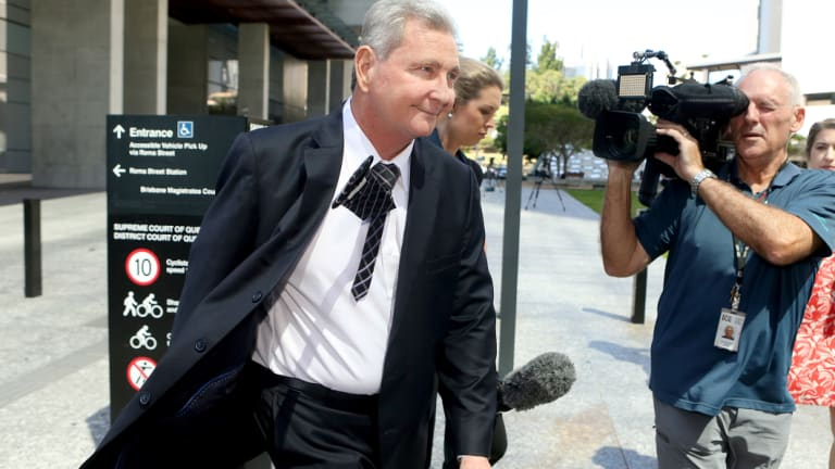 Wayne Myers leaves court on Thursday afternoon surrounded by a media scrum.