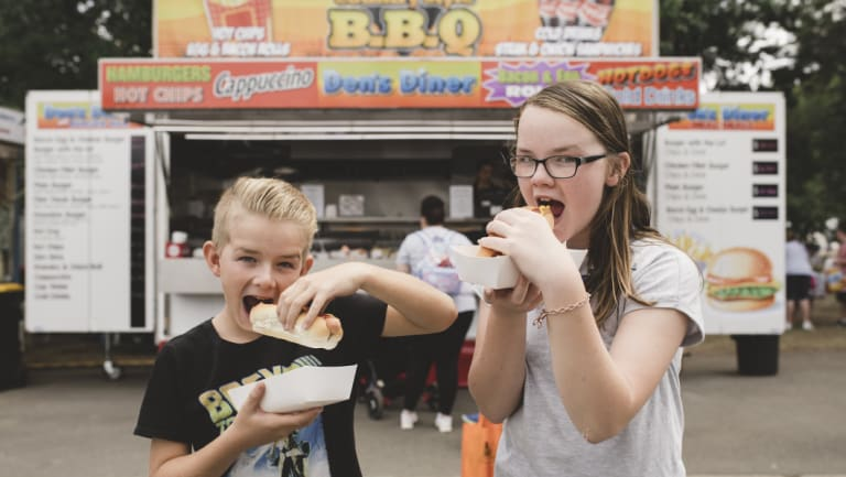 Prefer traditional show fare? Riley and Jessica Element enjoy a hotdog at last year's show.