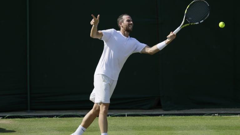 Adrian Mannarino of France returns a ball at Wimbledon.
