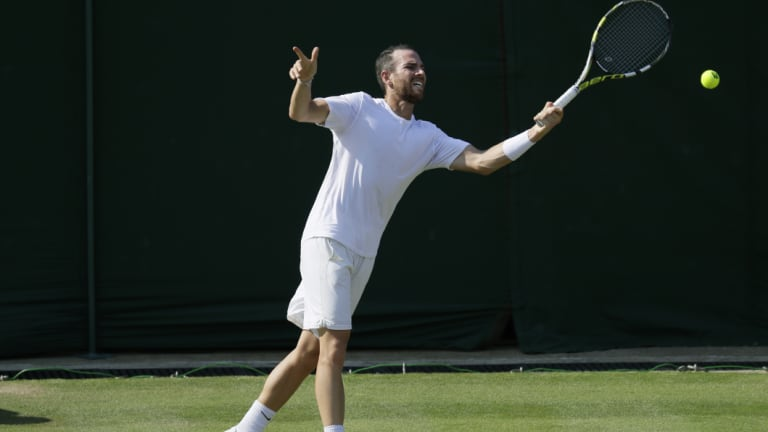 Adrian Mannarino of France returns a ball at Wimbledon.