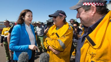 Queensland Premier Annastacia Palaszczuk meets with rural firefighters at the Peregian Springs Control Centre on Thursday.