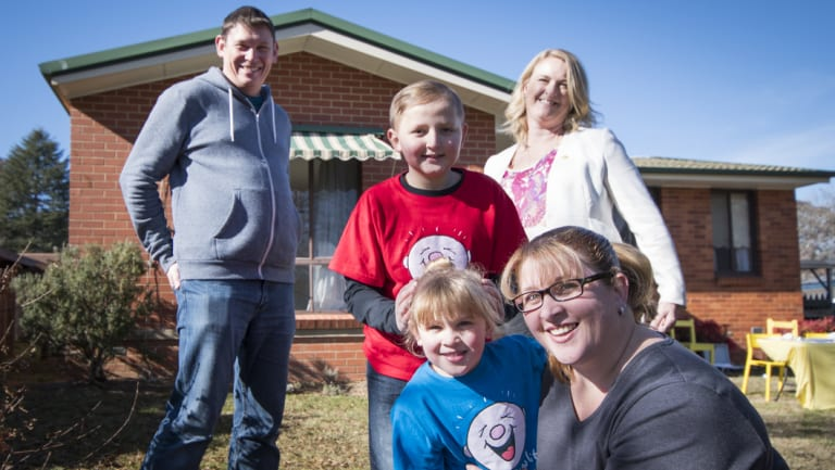 Bungendore family Stu and Bec Little with their two children Ryan and Zoe, alongside Camp Quality chief executive Kylea Tink.