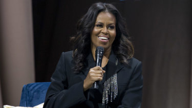 """Michelle Obama speaks to the crowd as she presents her anticipated memoir """"Becoming"""" during her book tour stop in Washington, on Saturday."""