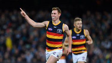 Tom Lynch of the Crows celebrates a goal against Port Adelaide.