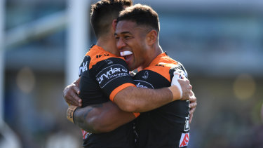 Michael Chee Kam of the Wests Tigers celebrates after scoring a try.