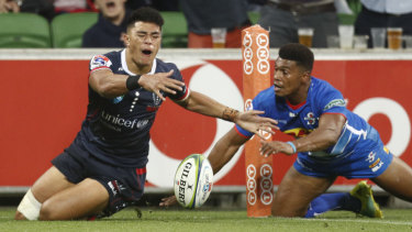 The Rebels' Semisi Tupou and the Stormers' Damian Willemse vie for the ball.