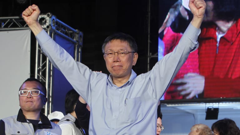 Re-elected Taipei city mayor  Ko Wen-je celebrates his victory with supporters in Taipei, Taiwan, early on Sunday.