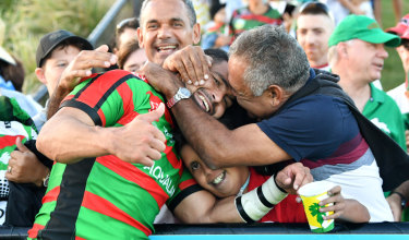 That's my boy! Souths star Cody Walker is embraced by his father Bernie after his big day on the Sunshine Coast.