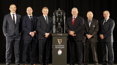 Detente: The Six Nations coaches pose at the season launch. From left, Scotland's Gregor Townsend, Italy's Conor O'Shea, Ireland's Joe Schmidt, Wales' Warren Gatland, England's Eddie Jones and France's Jacques Brunel.