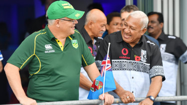 Prime Minister Scott Morrison enjoys the match with his Fijian counterpart Frank
