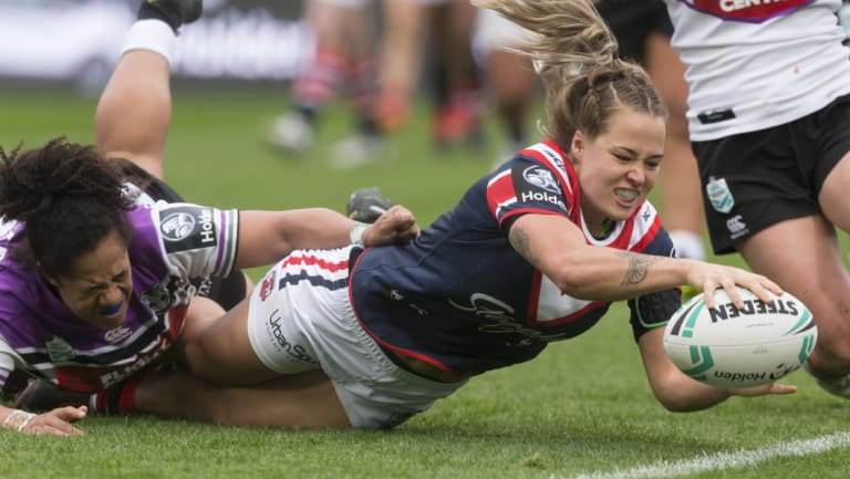 High standard: Isabelle Kelly scores for the Roosters against the Warriors on Saturday.