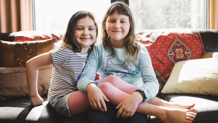 Lucinda McGarrigan, nine, (right) with her sister Eleanor, seven. Lucinda's next plan is to volunteer for Vinnies.