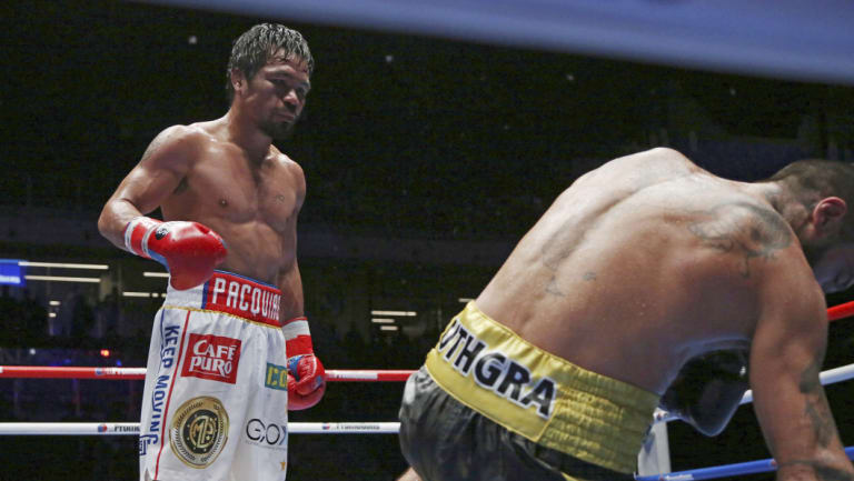 Fall guy: Manny Pacquiao knocks down Lucas Matthysse in Kuala Lumpur.