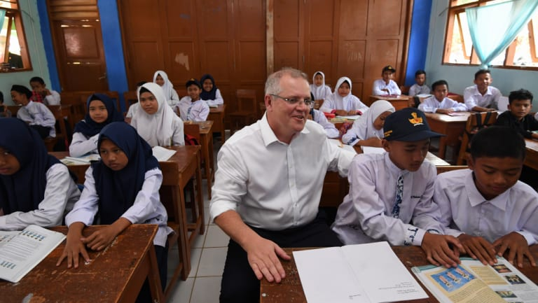 Australian Prime Minister Scott Morrison speaks to students at SMPN 2 Babakan Madang High school in Jakarta, his first overseas trip as PM.