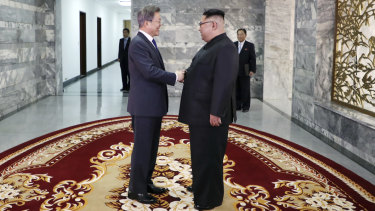 South Korean President Moon Jae-in, left, and North Korean leader Kim Jong-un shake hands before their meeting at the northern side of the Panmunjom in North Korea on May 26.