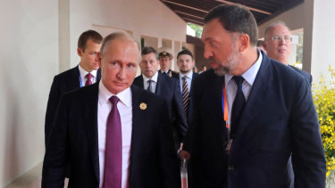 Russian metals magnate Oleg Deripaska, pictured with President Vladimir Putin, is one of several oligarchs to have sanctions placed on them.