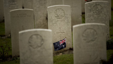 An Australian flag adorns the headstone of an unknown soldier at the World War I Australian National Memorial in Villers-Bretonneux, France.