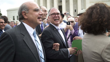 James Obergefell, centre, plaintiff in the same-sex marriage case Obergefell v Hodges, walks out of the Supreme Court following its ruling in June 2015.