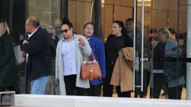 Family members of Epenesa Pahiva leave court on Tuesday.