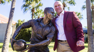 Alfie immortalised: Allan Langer with his new statue at Suncorp Stadium. Andrew Gee was a surprise attendee at the unveiling.