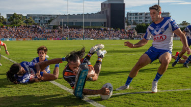 Mahe Fonua spectacularly crosses in the corner for the Tigers.