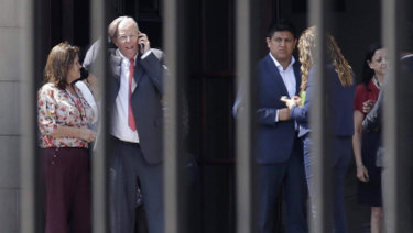 Peruvian President Pedro Pablo Kuczynski talks on his phone as he vacates the Government Palace in Lima on Wednesday.