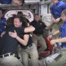 Out of space: Astronauts 'cram' into space station after SpaceX crew arrives on used rocket