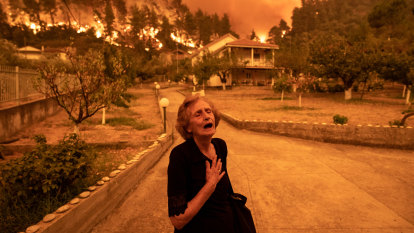 'Like a horror movie': rage at Athens as 'unprecedented' fire sweeps island
