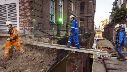 Sitting on a platform of wood, Amsterdam's historic canal districts are crumbling