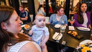 Brand new world: Angie Tiori out with her three-month-old daughter Olivia in Oakleigh's Eaton Mall.