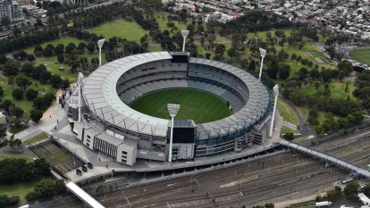 Positive COVID-19 case attended AFL match at the MCG, authorities say