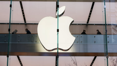 Apple's more than 3 per cent gain at midday helped lift Wall Street to record highs.