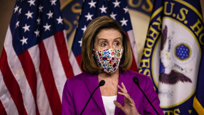 FBI hunt for woman accused of stealing Pelosi's laptop to sell to Russians