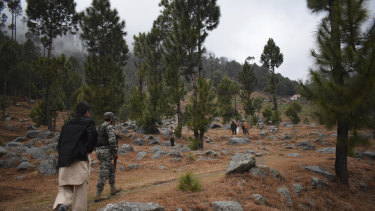 Pakistani troops visit the site of an Indian air strike in Jaba, near Balakot, Pakistan, on Tuesday. Pakistan said there were no casualties.
