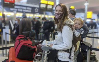 Kate Smith with her one-year-old son, Lleyton, at Heathrow Airport checking in for flight QF110 to Darwin, which landed on Friday.