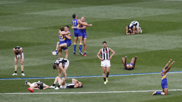 Agony and ecstasy: The Eagles and Magpies react after the final siren.