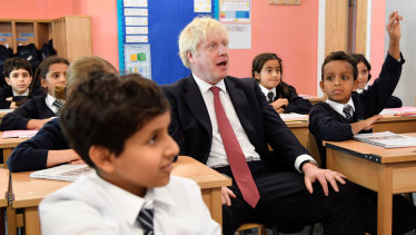 Britain's Prime Minister Boris Johnson attends a year six history class with pupils during a visit to Pimlico Primary School.