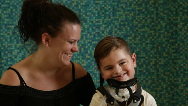 Kristie Duck and her son Kobe, 6, who has a rare disease that has left him paralysed.