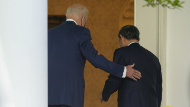 US President Joe Biden, accompanied by Japanese Prime Minister Yoshihide Suga, walk back into the Oval Office after a news conference in the Rose Garden of the White House in Washington.