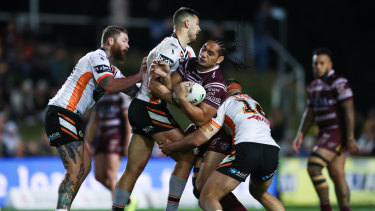Better together: the Tigers defence has been much improved under Michael Maguire.