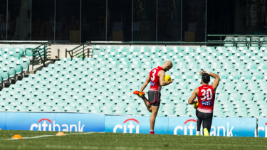 Adam Goodes and Jarrad McVeigh at training back in 2014.