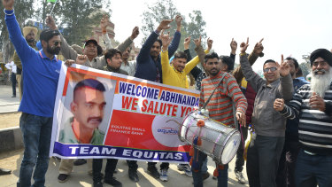 Indians dance as they wait to welcome Indian fighter pilot Wing Commander Abhinandan Varthaman at the border.