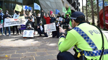 Extinction Rebellion protesters target the Perth HQ of Chevron on Friday morning.