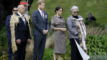Prince Harry and Meghan, the Duchess of Sussex, attend the traditional welcome ceremony on the lawns of Government House in Wellington.