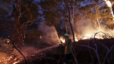 A firefighter tackles bushfires in NSW.